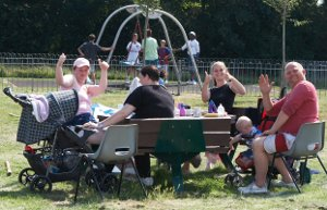 Group of residents give thumbs up to new play equipment