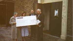 Residents being presented with a large cheque