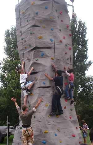 Young people using a climbing wall